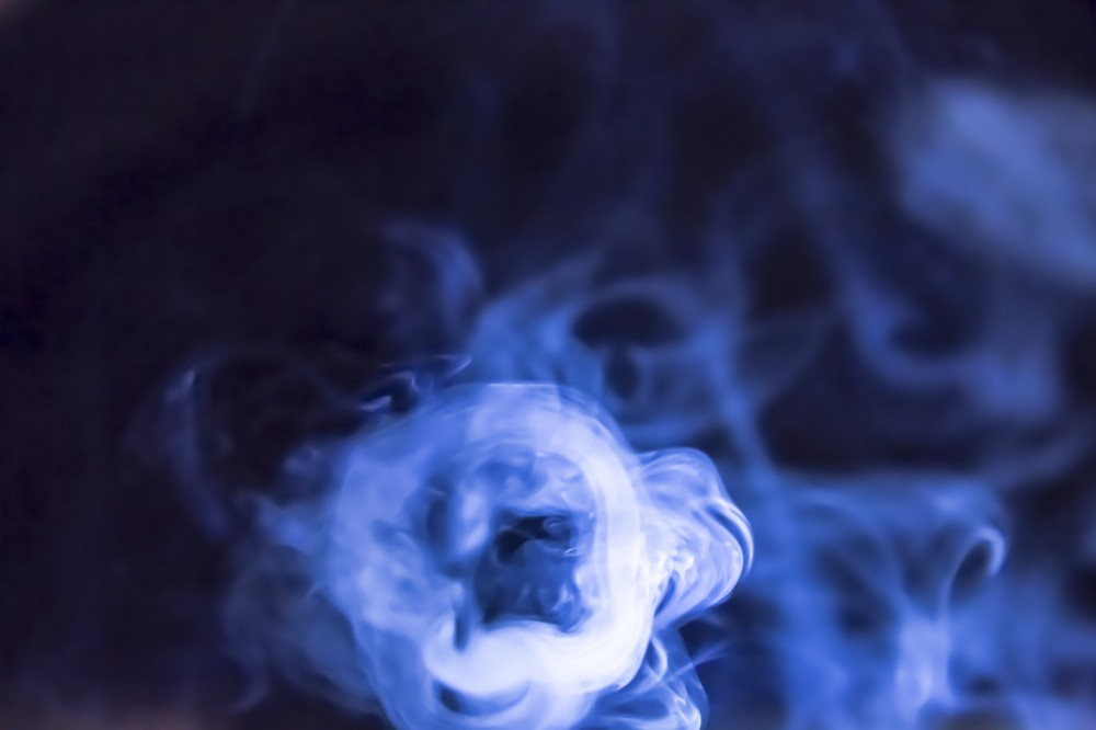 Smoke from a cigarette lit by a powerful torch to highlight the patterns.