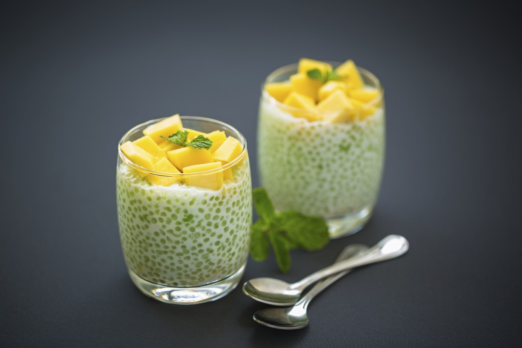 Tapioca pearls pudding with fresh mango in glasses